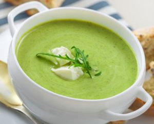 Delicious broccoli cream soup with rye bread . International cuisine meal.